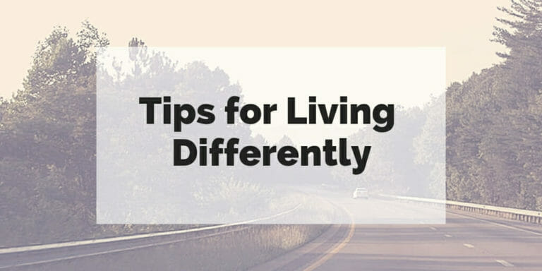 """Curving road through natural landscape with text """"tips for living differently"""" superimposed over it."""