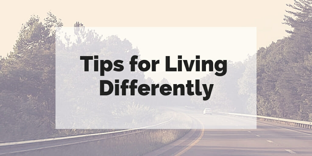 "Curving road through natural landscape with text ""tips for living differently"" superimposed over it."