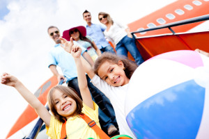 Happy-kids-traveling-by-airpla-30973445