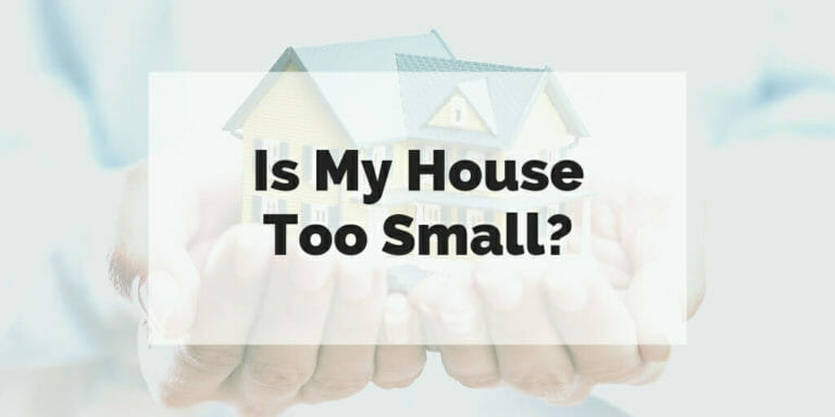Is my house too small? Text super-imposed over image of small, toy house held in a person's hands.